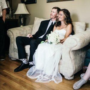 Size 4 wedding dress. Worn once at my mini wedding